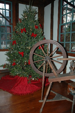 Spinning Wheel and Christmas Tree, alt. view of Living Room decorated for the Holidays
